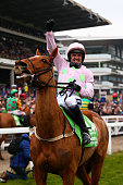 Ruby Walsh celebrates after riding Annie Power to victory in the Stan James Champion Hurdle Challenge Trophy Race on day one Champion Day of the...