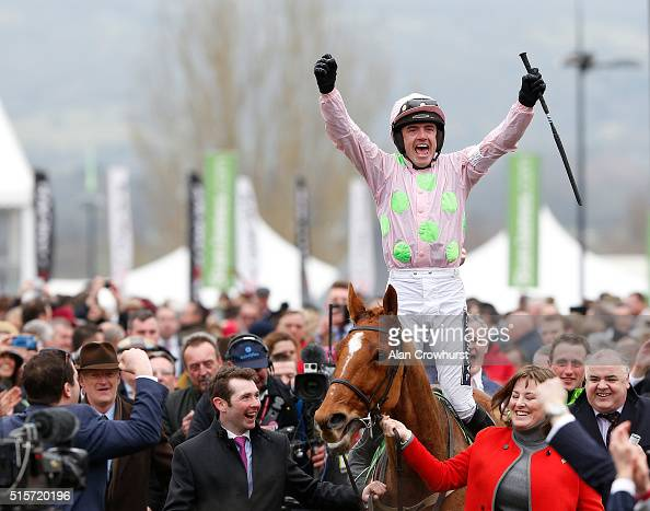 Ruby Walsh celebrates after riding Annie Power to win The Stan James Champion Hurdle Challenge trophy at Cheltenham racecourse on March 15 2016 in...