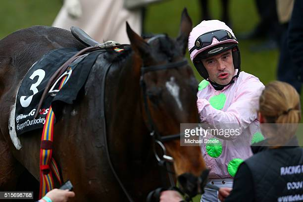 Ruby Walsh celebrates in the winners' enclosure after riding Douvan to victory in the Racing Post Arkle Challenge Trophy Chase on day one Champion...