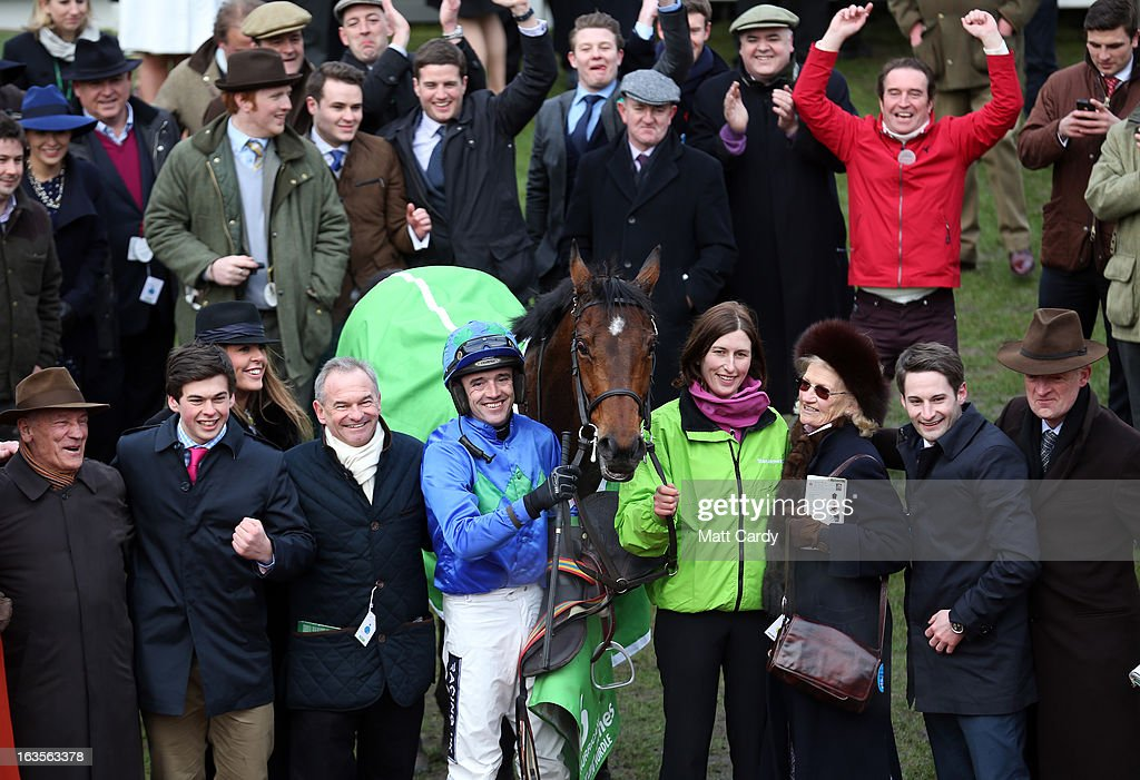 Ruby Walsh celebrates in the Winners Enclosure with Hurricane Fly after winning The Stan James Champion Hurdle Challenge Trophy during Champion Day at Cheltenham Racecourse on the first day of the Cheltenham Festival 2013 on March 12, 2013 in Cheltenham, England. Approximately 200,000 racing enthusiasts are expected at the four-day festival, which opened today and is seen as many as the highlight of the jump racing calendar.