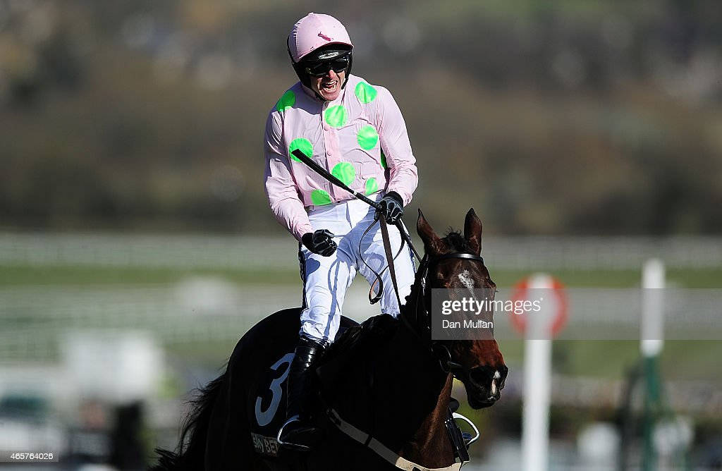 Ruby Walsh celebrates on board Douvan after winning The Sky Bet Supreme Novices' Hurdle Race during Day One of the Cheltenham Festival at Cheltenham...