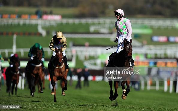 Ruby Walsh celebrates on board Douvan as they cross the line to win The Sky Bet Supreme Novices' Hurdle Race during Day One of the Cheltenham...