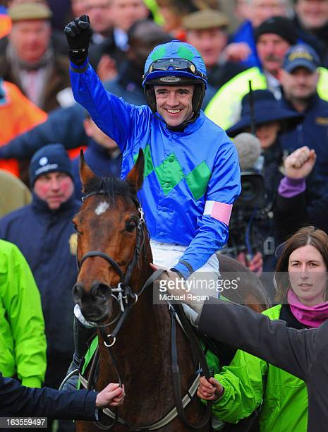Ruby Walsh celebrates on Hurricane Fly after winning The Stan James Champion Hurdle Challenge Trophy during Champion Day at Cheltenham Racecourse on...