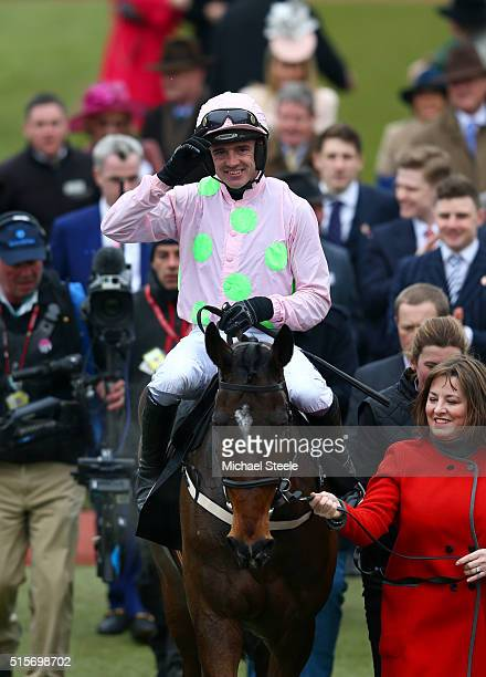 Ruby Walsh enters the winners' enclosure after riding Douvan to victory in the Racing Post Arkle Challenge Trophy Chase on day one Champion Day of...