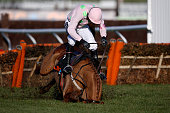 Ruby Walsh falls from Annie Power at the last when clear in The OLBG Mare' Hurdle Race at Cheltenham racecourse on March 10 2015 in Cheltenham England