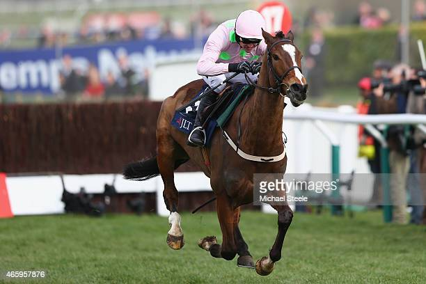 Ruby Walsh heads to victory on Vautour iin the JLT Novices' Steeplechase during day three of the Cheltenham Festival at Cheltenham Racecourse on...
