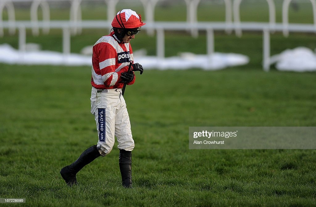 <a gi-track='captionPersonalityLinkClicked' href=/galleries/search?phrase=Ruby+Walsh&family=editorial&specificpeople=171838 ng-click='$event.stopPropagation()'>Ruby Walsh</a> holds his arm after falling from Curtain Razer in The Pertemps Handicap Hurdle Race at Newbury racecourse on November 30, 2012 in Newbury, England.