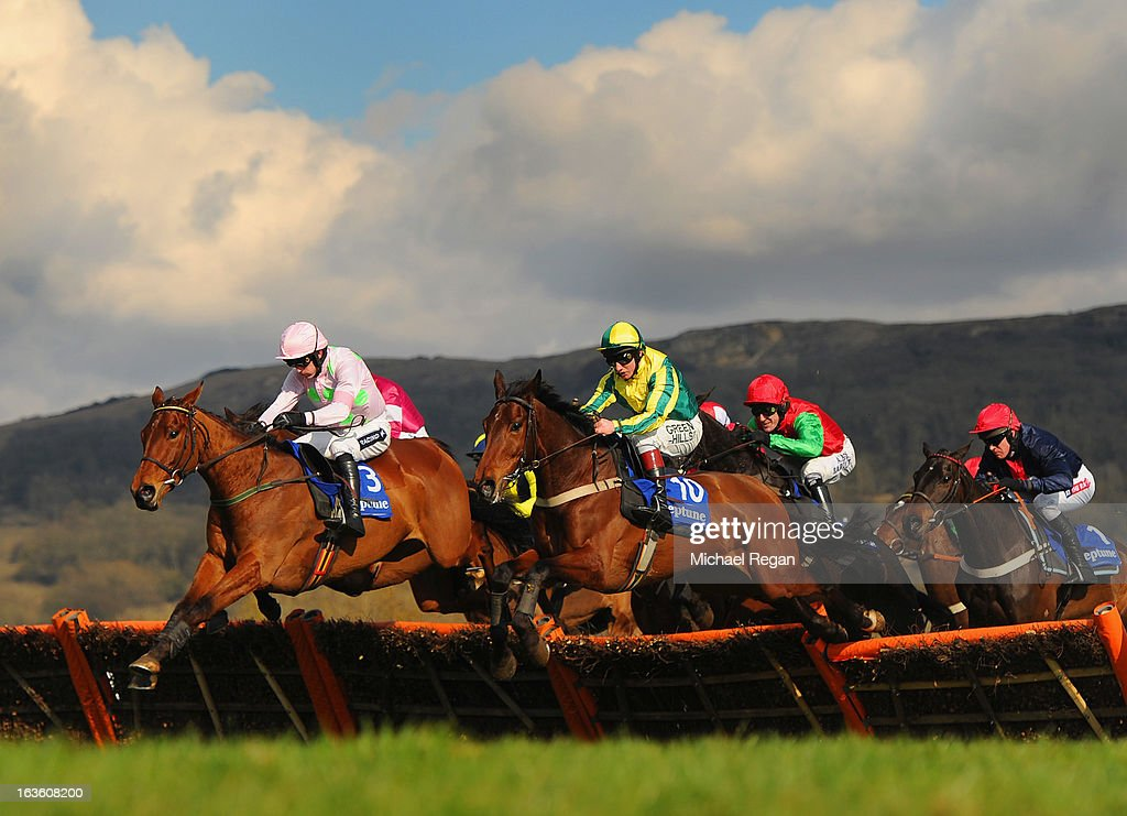 Ruby Walsh on Pont Alexandre leads Jamie Moore on Ubak in the Neptune Investment Management Novices' Hurdle during Ladies Day at Cheltenham...