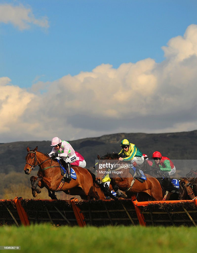 <a gi-track='captionPersonalityLinkClicked' href=/galleries/search?phrase=Ruby+Walsh&family=editorial&specificpeople=171838 ng-click='$event.stopPropagation()'>Ruby Walsh</a> on Pont Alexandre (L) leads <a gi-track='captionPersonalityLinkClicked' href=/galleries/search?phrase=Jamie+Moore+-+Jockey&family=editorial&specificpeople=220586 ng-click='$event.stopPropagation()'>Jamie Moore</a> on Ubak in the Neptune Investment Management Novices' Hurdle during Ladies Day at Cheltenham Racecourse on March 13, 2013 in Cheltenham, England.