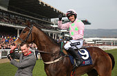 Ruby Walsh on Vautour celebrates after winning the JLT Novices' Chase during St Patrick's Thursday at the Cheltenham Festival at Cheltenham...