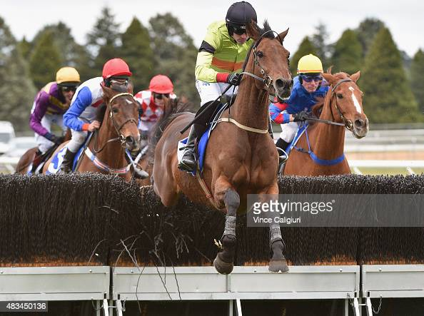 Ruby Walsh riding Bashboy jumping the last hurdle of first lap before winning Race 4 The Ecycle Grand National Steeplechase during Grand National...