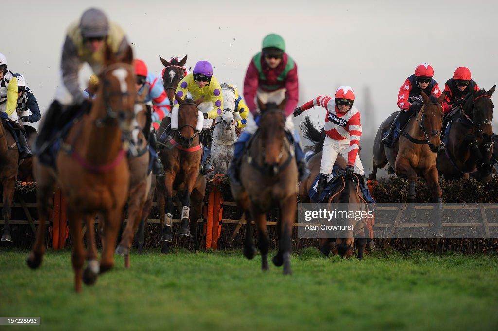 <a gi-track='captionPersonalityLinkClicked' href=/galleries/search?phrase=Ruby+Walsh&family=editorial&specificpeople=171838 ng-click='$event.stopPropagation()'>Ruby Walsh</a> riding Curtain Razer (3rd R) fall in The Pertemps Handicap Hurdle Race at Newbury racecourse on November 30, 2012 in Newbury, England.