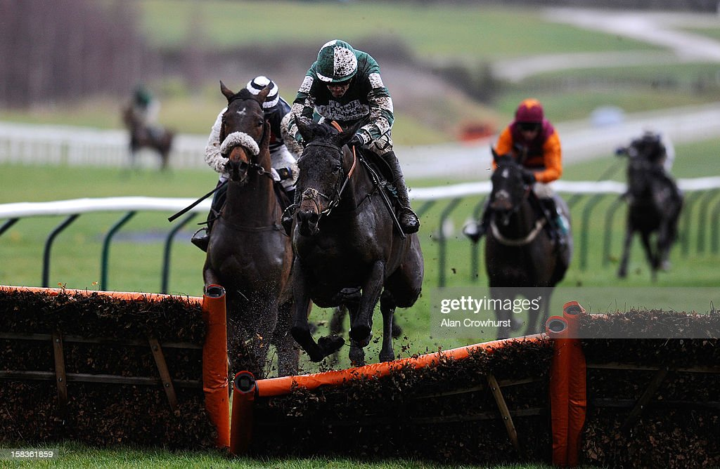 <a gi-track='captionPersonalityLinkClicked' href=/galleries/search?phrase=Ruby+Walsh&family=editorial&specificpeople=171838 ng-click='$event.stopPropagation()'>Ruby Walsh</a> riding Dark Lover smash through the last to win The CF Roberts Electrical + Mechanical Services Handicap Hurdle Race at Cheltenham racecourse on December 14, 2012 in Cheltenham, England.