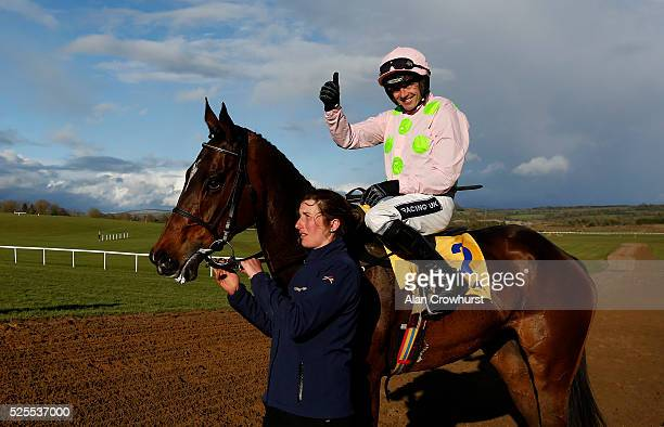 Ruby Walsh riding Douvan pose with head lass Gail Carlisle after winning The Ryanair Novice Steeplechase at Punchestown racecourse on April 28 2016...