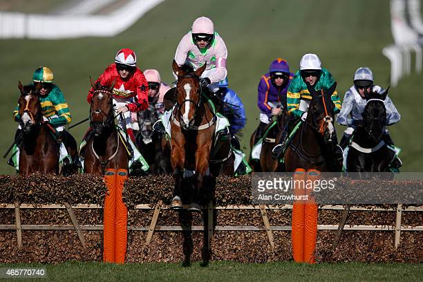 Ruby Walsh riding Faugheen clear the second flight of hurdles on their way to winning The Stan James Champion Hurdle at Cheltenham racecourse on...