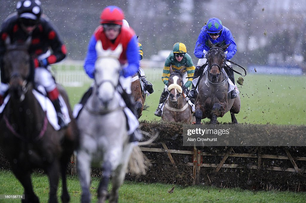 Ruby Walsh riding Hurricane Fly (R) clear the first flight of hurdles before winning The BHP Insurance Irish Champion Hurdle at Leopardstown racecourse on January 27, 2013 in Dublin, Ireland.