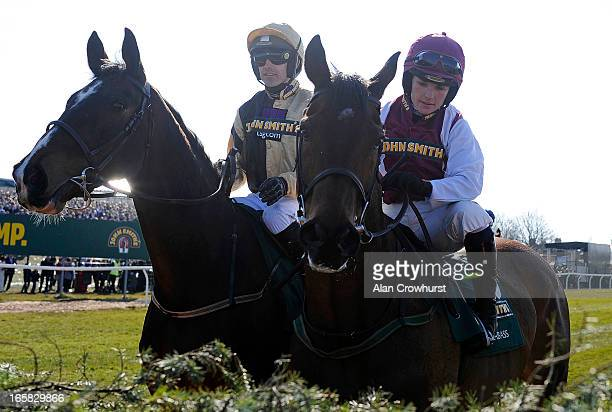 Ruby Walsh riding On His Own with his sister Katie Walsh on Seabass inspect the first fence before The John Smith's Grand National Steeple Chase at...