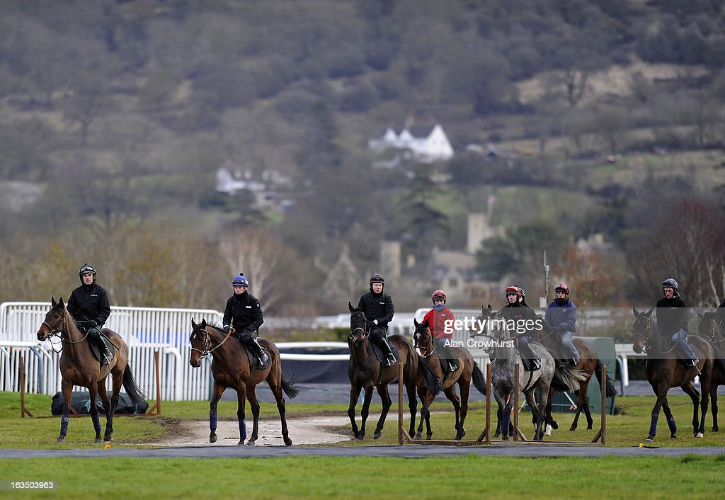 Ruby Walsh riding Quevega (L) and Paul Townend riding Hurricane Fly (2L) walk round the gallops at Cheltenham racecourse on March 11, 2013 in Cheltenham, England.