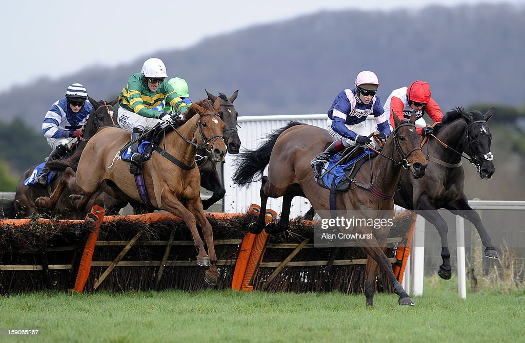 <a gi-track='captionPersonalityLinkClicked' href=/galleries/search?phrase=Ruby+Walsh&family=editorial&specificpeople=171838 ng-click='$event.stopPropagation()'>Ruby Walsh</a> riding Saphir Du Rheu (R) take a hurdle down the back straight before winning The Castle Hotel In Taunton 'National Hunt' Novices' Hurdle Race at Taunton racecourse on January 07, 2013 in Taunton, England.