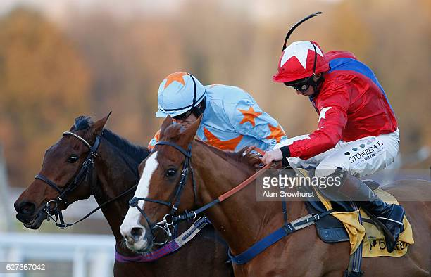 Ruby Walsh riding Un De Sceaux clear the last to win The Betfair Tingle Creek Steeple Chase from Sire De Grugy at Sandown Park on December 3 2016 in...