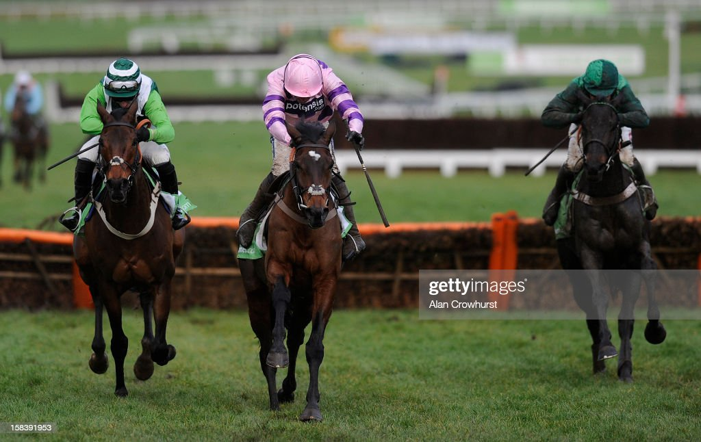 <a gi-track='captionPersonalityLinkClicked' href=/galleries/search?phrase=Ruby+Walsh&family=editorial&specificpeople=171838 ng-click='$event.stopPropagation()'>Ruby Walsh</a> riding Zarkandar (C) clear the last to win The StanJames.com International Hurdle Race at Cheltenham racecourse on December 15, 2012 in Cheltenham, England.