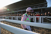 Ruby Walsh walks back along the main grandstand after falling at the last riding Annie Power during the Olbg Mares' Hurdle Race on day one at...