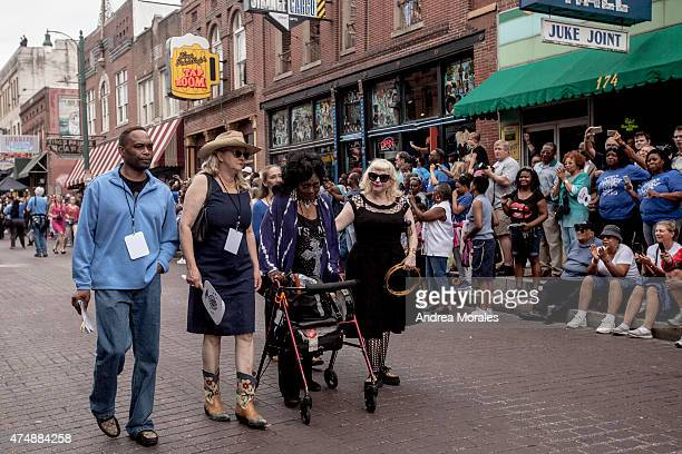 Ruby Wilson a singer who goes by the nickname 'Queen of Beale Street' walks in the processional down Beale Street following the memorial in honor of...