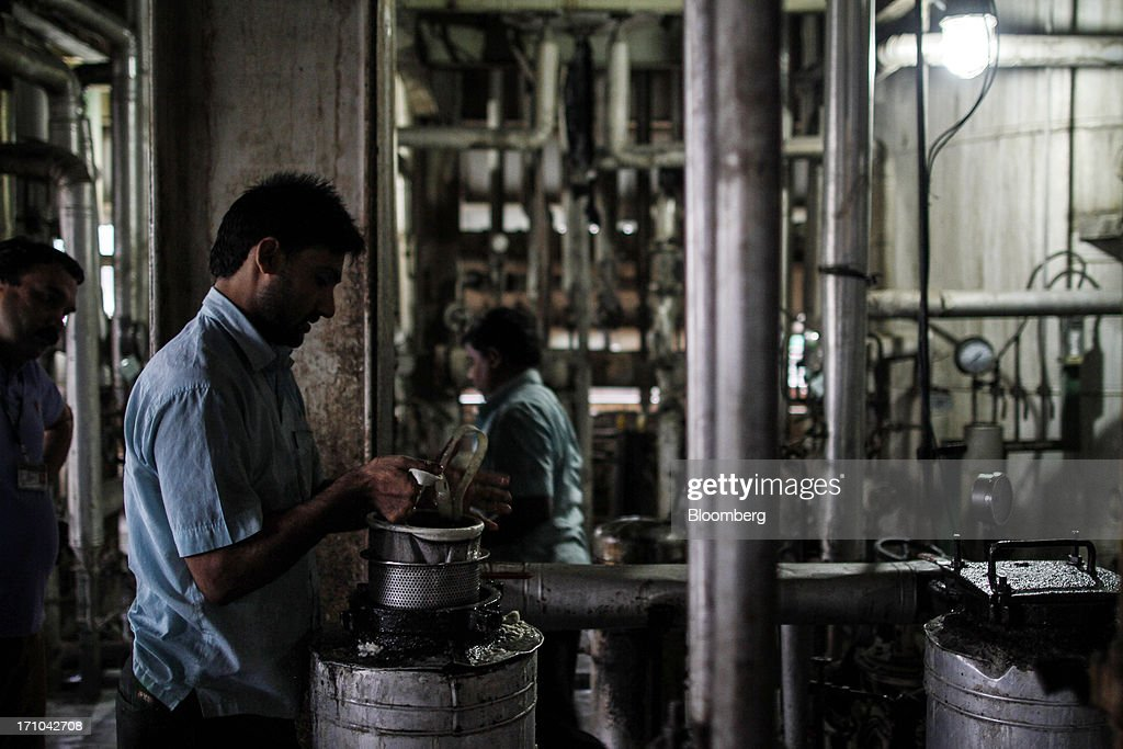 A Ruchi Soya Industries Ltd. employee operates an oil polishing filtration machine in the vanaspati oil manufacturing department of the company's edible oil refinery plant in Patalganga, India, on Tuesday, June 18, 2013. Monsoon, which accounts for 70 percent of Indias annual rainfall, covered the entire country in a record time, accelerating plantings of crops from rice to soybeans and cotton. Rains covered the whole of India by June 16, the earliest ever and ahead of the normal date of July 15, said D.S. Pai, head of the long-range forecasting division at the India Meteorological Department. Photographer: Dhiraj Singh/Bloomberg via Getty Images