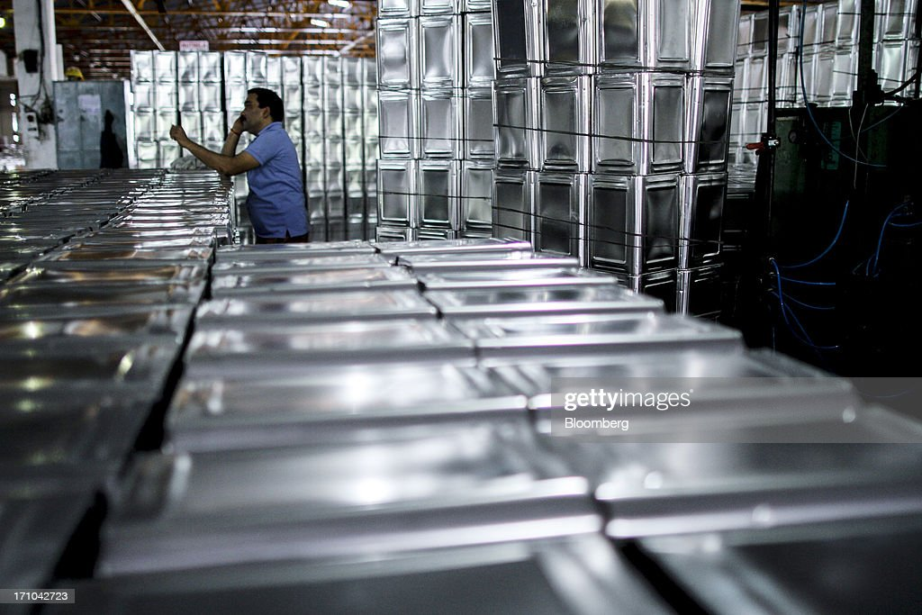 A Ruchi Soya Industries Ltd. employee uses his mobile phone beside stacks of empty 15 liter oil tin containers at the company's edible oil refinery plant in Patalganga, India, on Tuesday, June 18, 2013. Photographer: Dhiraj Singh/Bloomberg via Getty Images Monsoon, which accounts for 70 percent of Indias annual rainfall, covered the entire country in a record time, accelerating plantings of crops from rice to soybeans and cotton. Rains covered the whole of India by June 16, the earliest ever and ahead of the normal date of July 15, said D.S. Pai, head of the long-range forecasting division at the India Meteorological Department. Photographer: Dhiraj Singh/Bloomberg via Getty Images