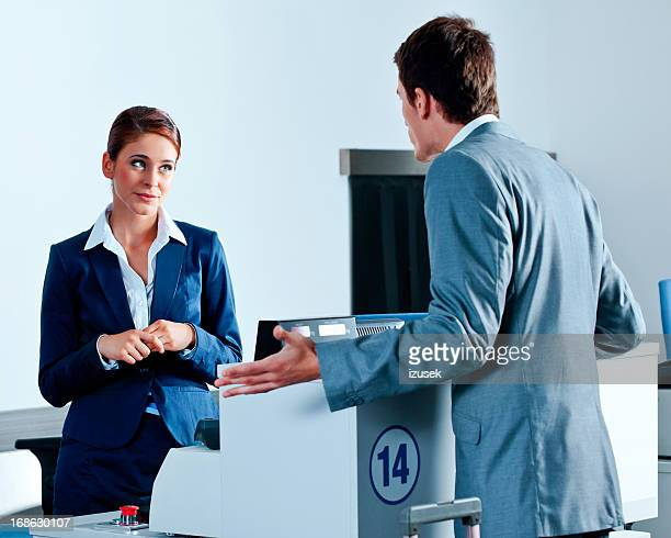 Rude businessman at the airport check-in