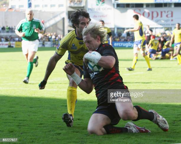 Rudi Keil of Sale scores the third try during the Heineken Cup match between ASM Clermont Auvergne v Sale Sharks at Stade Marcel Michelin on October...
