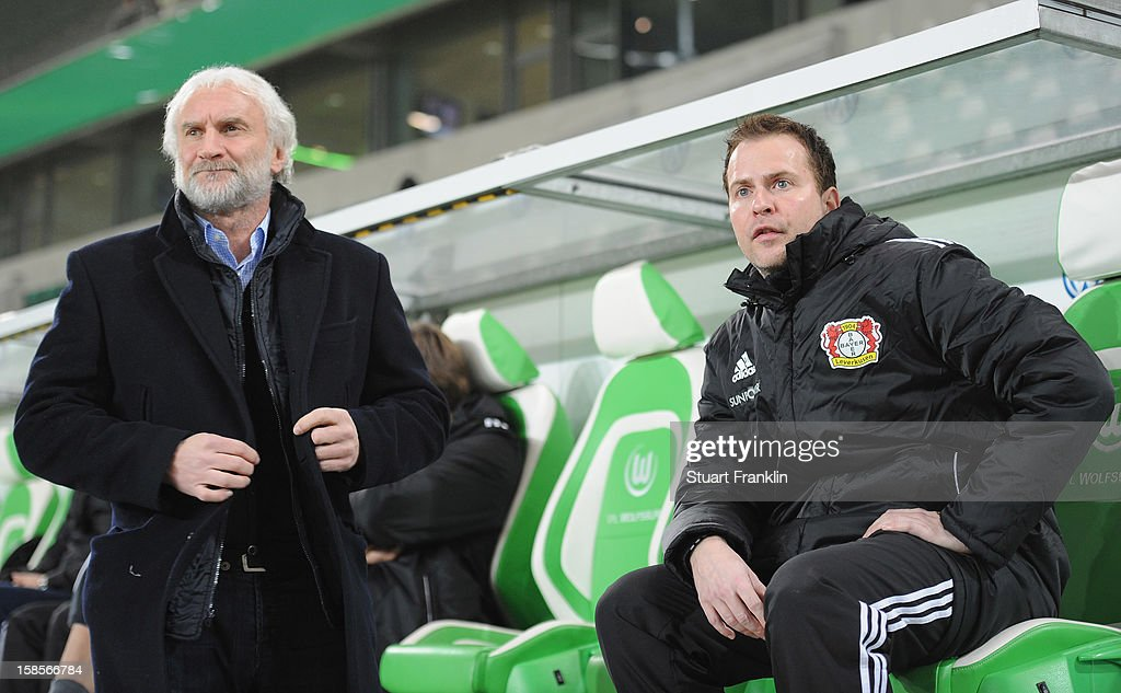 Rudi Voller, sport director of Leverkusen and Sascha Lewandowski, trainer of Leverkusen ponder during the round of 16 of the DFB cup match between VfL Wolfsburg and Bayer Leverkusen at Volkswagen Arena on December 19, 2012 in Wolfsburg, Germany.