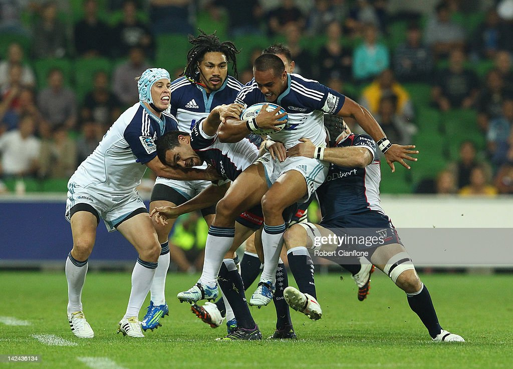 <a gi-track='captionPersonalityLinkClicked' href=/galleries/search?phrase=Rudi+Wulf&family=editorial&specificpeople=818216 ng-click='$event.stopPropagation()'>Rudi Wulf</a> of the Blues is tackled by his opponents during the round seven Super Rugby match between the Melbourne Rebels and the Auckland Blues at AAMI Park on April 5, 2012 in Melbourne, Australia.