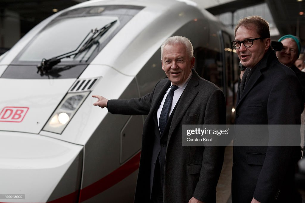 <a gi-track='captionPersonalityLinkClicked' href=/galleries/search?phrase=Rudiger+Grube&family=editorial&specificpeople=4409079 ng-click='$event.stopPropagation()'>Rudiger Grube</a> (L), CEO of Deutsche Bahn, and <a gi-track='captionPersonalityLinkClicked' href=/galleries/search?phrase=Alexander+Dobrindt&family=editorial&specificpeople=5702301 ng-click='$event.stopPropagation()'>Alexander Dobrindt</a> (R), Federal Minister of Transport and digital infrastructure, pose in front of the ICE 4 on a platform on December 4, 2015 in Berlin, Germany. In December 2017, the new long-distance train of Deutsche Bahn officially on the fleet name ICE 4, series 412 (BR 412) should be included in the normal operation. Currently the trains are being tested with the first passengers expected to travel on the fleet in 2016 during a trial operation.