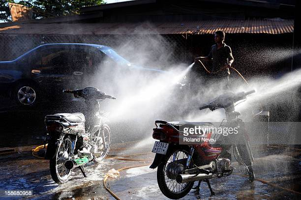 A rudimentary carwash shop in the eastern Cambodian town of Ratanakiri