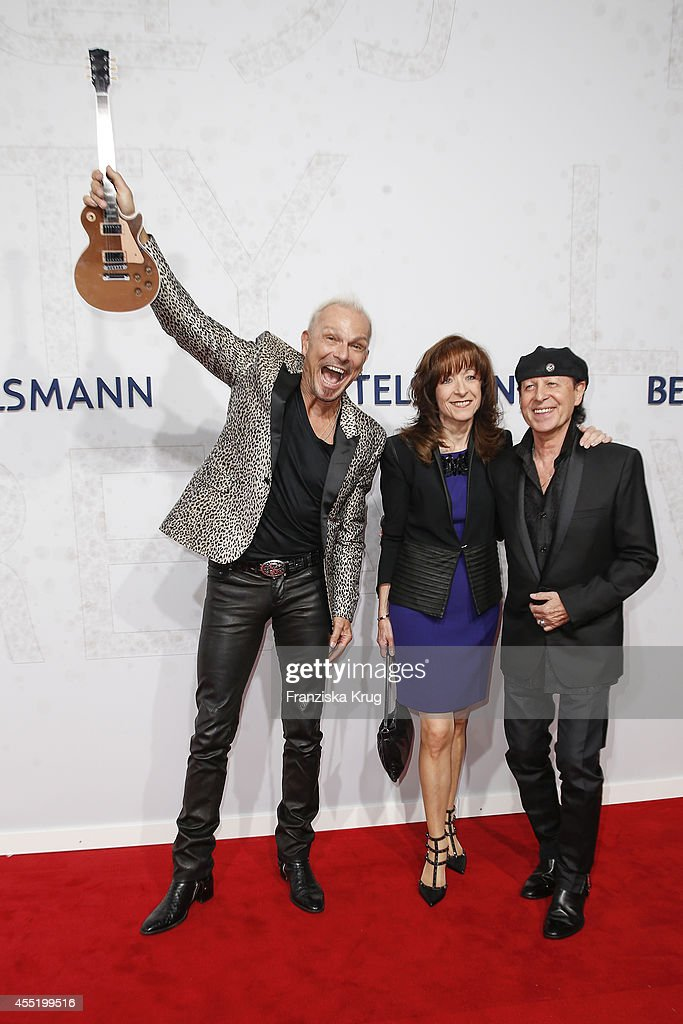 <a gi-track='captionPersonalityLinkClicked' href=/galleries/search?phrase=Rudolf+Schenker&family=editorial&specificpeople=710263 ng-click='$event.stopPropagation()'>Rudolf Schenker</a>, Gaby Meine and <a gi-track='captionPersonalityLinkClicked' href=/galleries/search?phrase=Klaus+Meine&family=editorial&specificpeople=240345 ng-click='$event.stopPropagation()'>Klaus Meine</a> attend the Bertelsmann Summer Party at the Bertelsmann representative office on September 10, 2014 in Berlin, Germany.