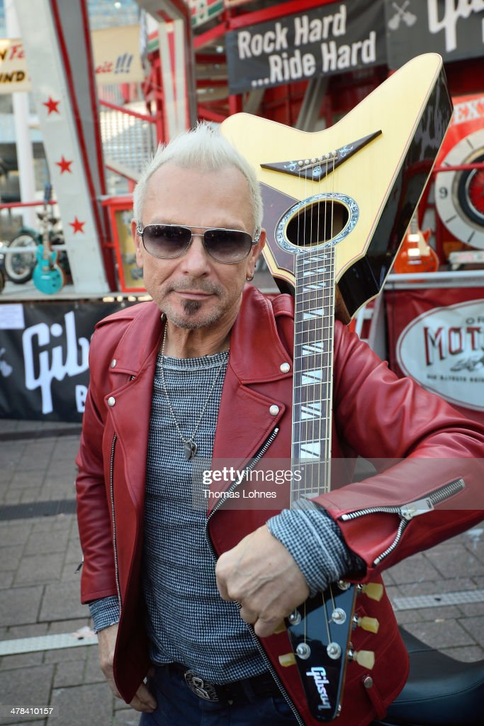 <a gi-track='captionPersonalityLinkClicked' href=/galleries/search?phrase=Rudolf+Schenker&family=editorial&specificpeople=710263 ng-click='$event.stopPropagation()'>Rudolf Schenker</a>, guitar player of the band Scorpions, poses with a 'Gibson Custom Acoustic Flying V' at Musikmesse on March 13, 2014 in Frankfurt am Main, Germany. The 'Musikmesse' in Frankfurt am Main from 12 to 15 March 2014 is an important meeting place for the musical-instrument sector. Manufacturers and trade visitors use to spotlight the latest trends in the music business and live entertainment worlds.