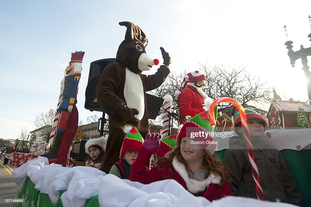 A Rudolph mascot waves on a float for Harvey's Salt Water Fishing Club and G.I. Ginger Betty Foundation during the Annual Christmas Parade in Quincy, Mass. on Sunday, November 25, 2012.