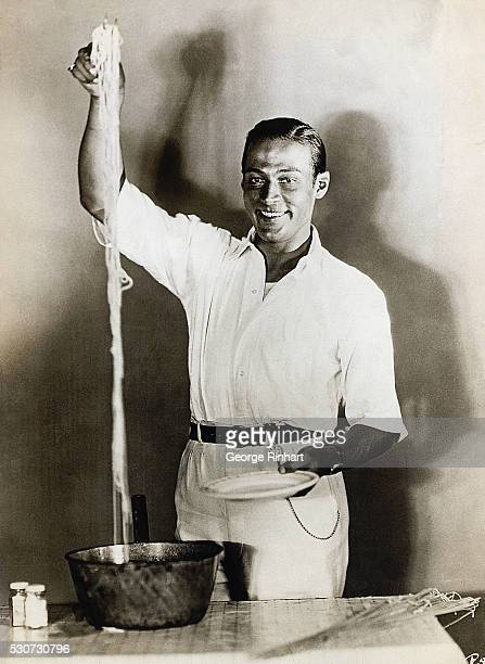 Rudolph Valentino Italianborn US actor seen serves himself spaghetti from a large pot Ca 19151926