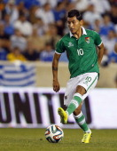 Rudy Cardozo of Bolivia handles the ball and scores a goal during the second half of an international friendly match against Greece at Red Bull Arena...
