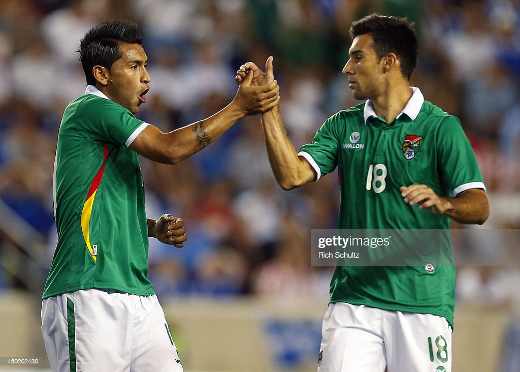 Rudy Cardozo of Bolivia is congratulated by teammate Danny Bejarano after scoring a goal during the second half of an international friendly match...
