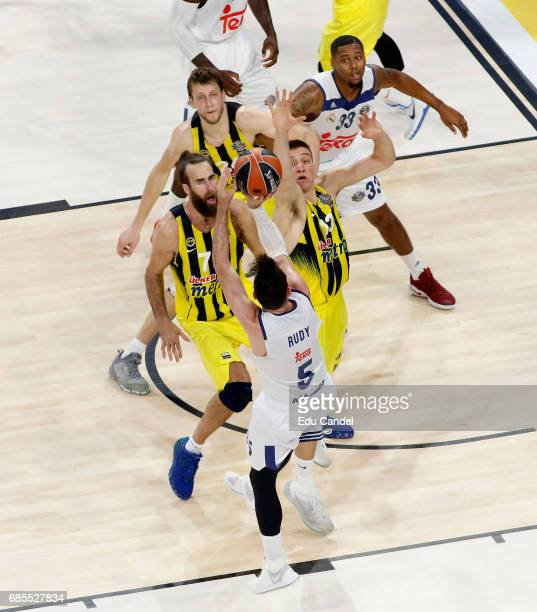 Rudy Fernandez #5 of Real Madrid competes with Luigi Datome #70 of Fenerbahce Istanbul and Bogdan Bogdanovic #13 of Fenerbahce Istanbul in action...