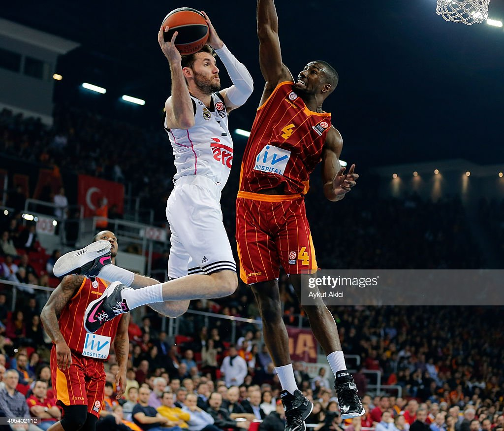 Rudy Fernandez #5 of Real Madrid competes with Patric Young #4 of Galatasaray Liv Hospital Istanbul during the Turkish Airlines Euroleague Basketball...