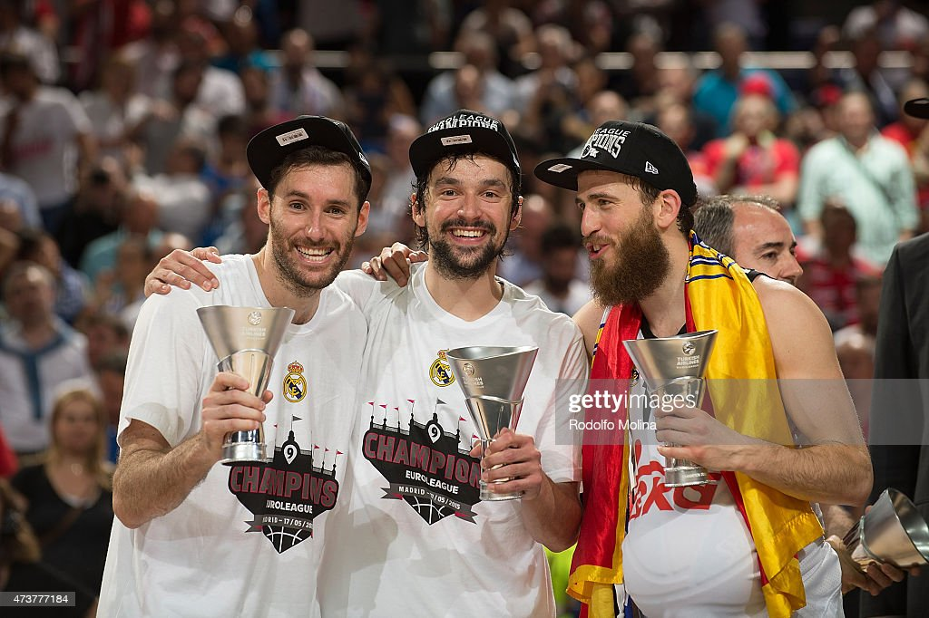 Rudy Fernandez, #5 of Real Madrid; <a gi-track='captionPersonalityLinkClicked' href=/galleries/search?phrase=Sergio+Llull&family=editorial&specificpeople=4537823 ng-click='$event.stopPropagation()'>Sergio Llull</a>, #23 and Sergio Rodriguez, #13 celebrates during the Turkish Airlines Euroleague Final Four Madrid 2015 Champion Trophy Ceremony at Barclaycard Center on May 17, 2015 in Madrid, Spain.