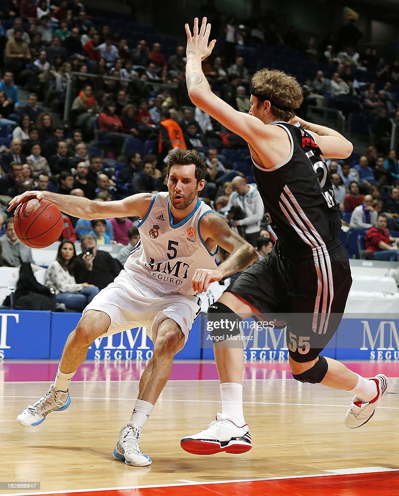 Rudy Fernandez #5 of Real Madrid drives against <a gi-track='captionPersonalityLinkClicked' href=/galleries/search?phrase=Matt+Walsh+-+Basketball+Player&family=editorial&specificpeople=13491253 ng-click='$event.stopPropagation()'>Matt Walsh</a> #55 of Brose Baskets during the Turkish Airlines Euroleague Top 16 game at Palacio de los Deportes on February 28, 2013 in Madrid, Spain.