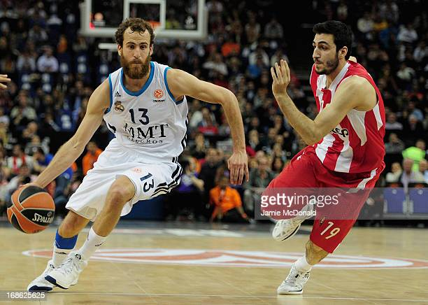Rudy Fernandez of Real Madrid tussles with Acie Law of Olympiacos Piraeus during the Turkish Airlines EuroLeague Final Four final between Olympiacos...