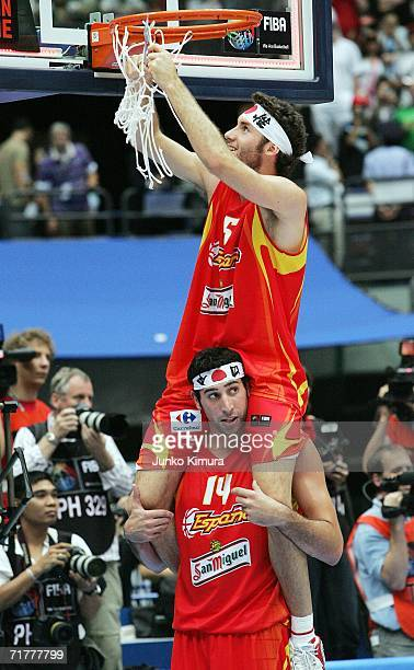 Rudy Fernandez of Spain cuts the net from the basket on the shoulders of teammate Alex Mumbru after playing at the finals at the 2006 FIBA World...