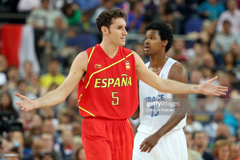 Rudy Fernandez #5 of Spain reacts in front of <a gi-track='captionPersonalityLinkClicked' href=/galleries/search?phrase=Mickael+Gelabale&family=editorial&specificpeople=700549 ng-click='$event.stopPropagation()'>Mickael Gelabale</a> #15 of France in the first half during the Men's Basketball quaterfinal game on Day 12 of the London 2012 Olympic Games at North Greenwich Arena on August 8, 2012 in London, England.