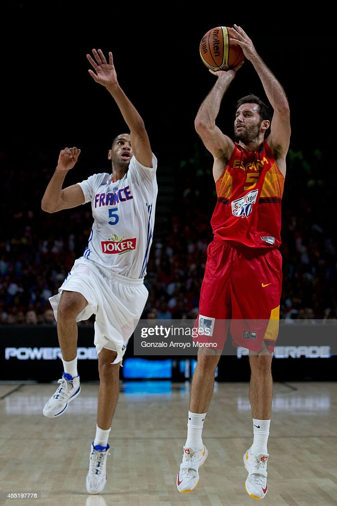 Rudy Fernandez of Spain shoots against Nicolas Batum of France during the 2014 FIBA World Basketball Championship quarter final match between France...