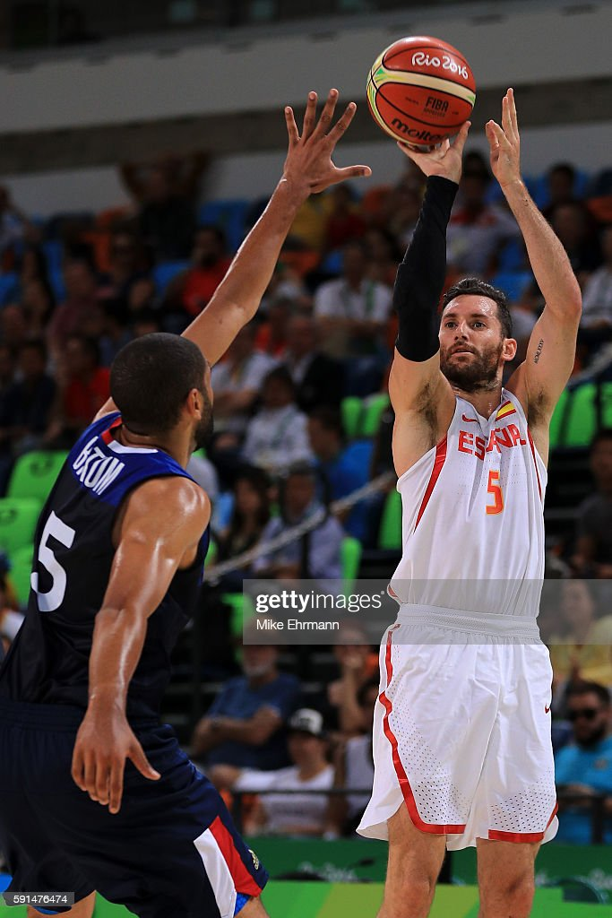 Rudy Fernandez of Spain shoots against Nicolas Batum of France during the Men's Quarterfinal match on Day 12 of the Rio 2016 Olympic Games at Carioca...